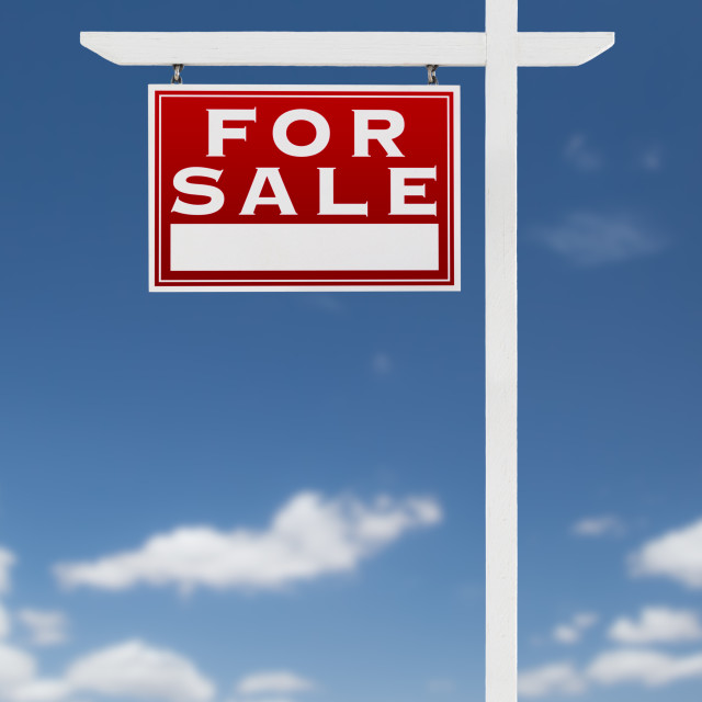 """Left Facing For Sale Real Estate Sign on a Blue Sky with Clouds."" stock image"