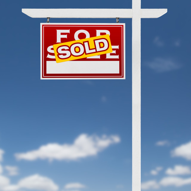 """Left Facing Sold For Sale Real Estate Sign on a Blue Sky with Clouds."" stock image"