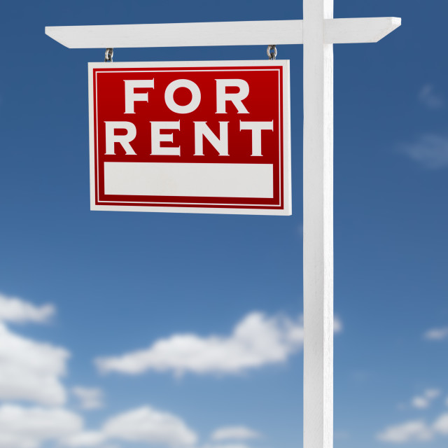 """Left Facing For Rent Real Estate Sign on a Blue Sky with Clouds."" stock image"