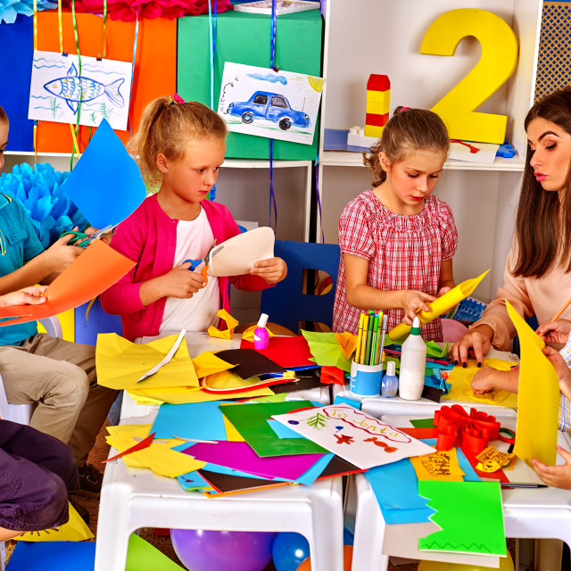 """""""Children are making something out of colored paper."""" stock image"""