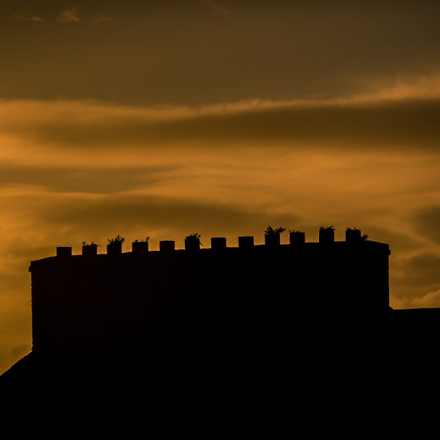 """Chimneys stacks and Roof-tops at sunset"" stock image"