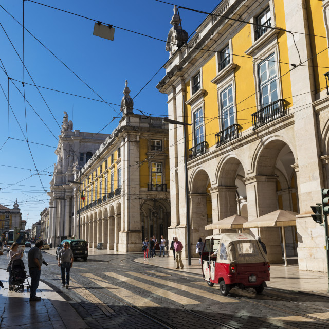 """""""Lisbon, Portugal - October 22, 2017: Street scene in the downtown (baixa) of Lisbon with people in a street and the Comercio Square (Praca do Comercio) on the background, in Lisbon, Portugal"""" stock image"""