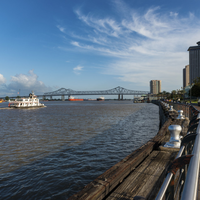 """""""New Orleans, Louisiana - June 17, 2014: View of the Mississippi river with boats from the city of New Orleans riverfron, with the Great New Orleans Bridge on the background in New Orleans, Louisiana, USA."""" stock image"""