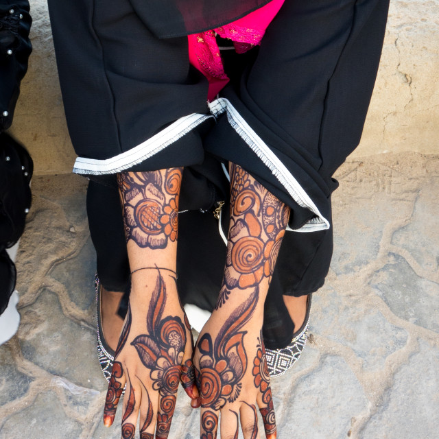 """Woman wearing a burqa showing her henna painted hands, Lamu Island, Kenya"" stock image"