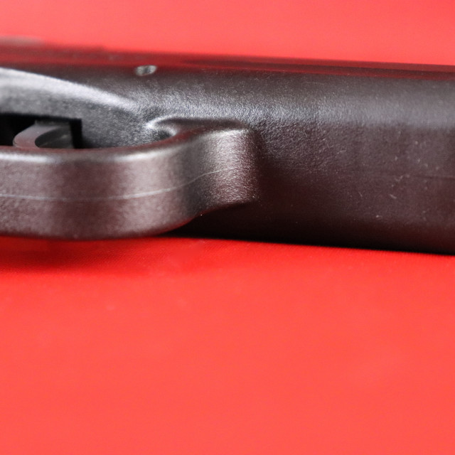 """""""closeup of isolated conseal carry pistol trigger guard and barrel"""" stock image"""