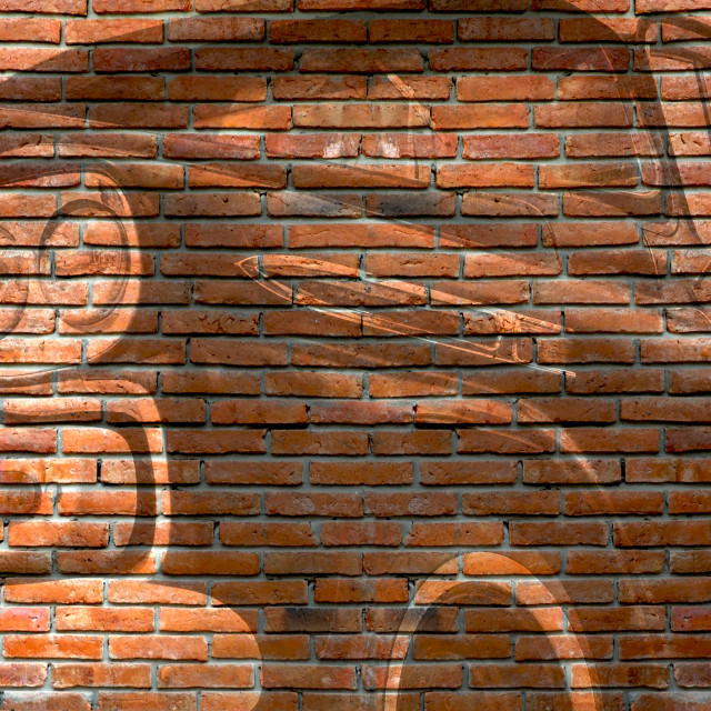 """Graffiti of a light-duty truck on an outdoor brick wall"" stock image"