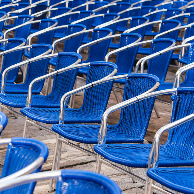 """""""Blue chairs in outdoors event"""" stock image"""