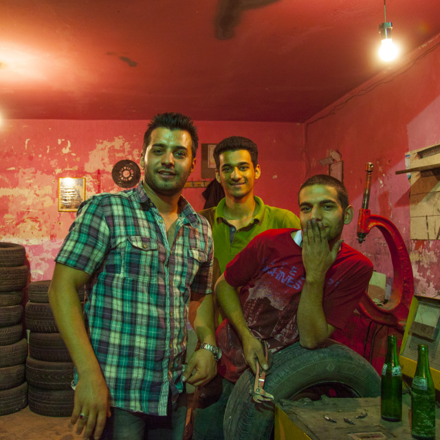 """Men In A Garage, Kermanshah, Iran"" stock image"