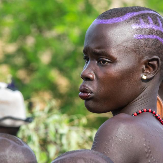 """Bodi girl attending Kael tribe ceremony, Gurra, Hana Mursi, Omo Valley, Ethiopia"" stock image"