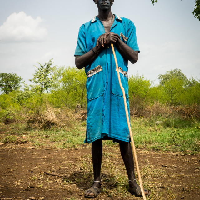 """Young man holding a stick, while attending Kael fat men ceremony, Gurra, Omo..."" stock image"