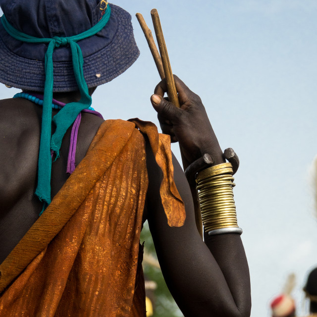 """Stylish man attending Kael ceremony, Gurra, Hana Mursi, Omo Valley, Ethiopia"" stock image"