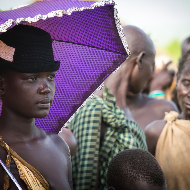 """Stylish girl attending Kael ceremony, Gurra, Hana Mursi, Omo Valley, Ethiopia"" stock image"