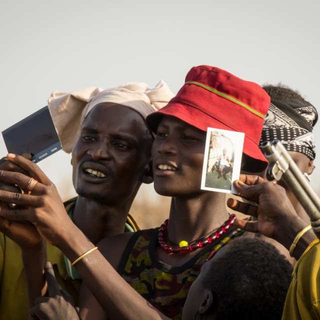 """Friends attending Dassanech Proud Ox celebration, Salheng,Turkana County,..."" stock image"