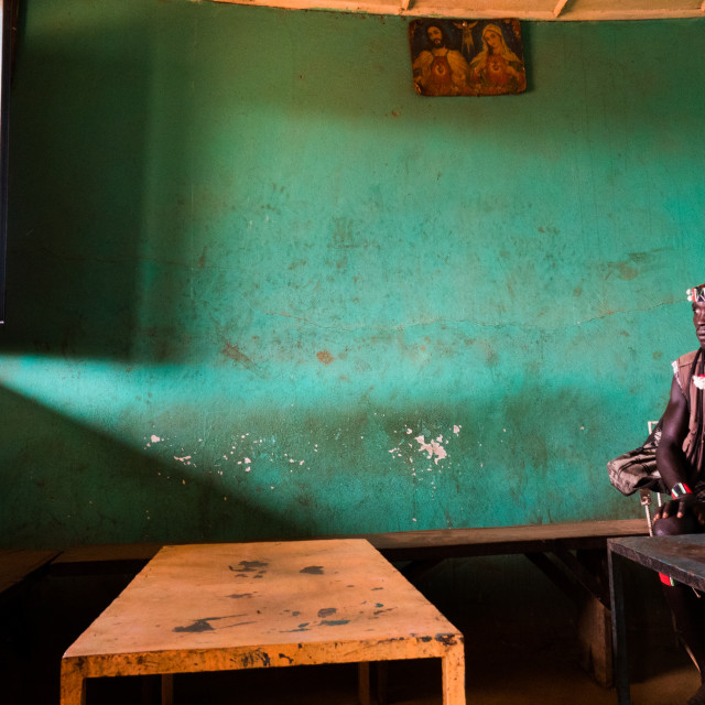 """""""Man inside a bar in Key Afer, Omo Valley, Ethiopia"""" stock image"""