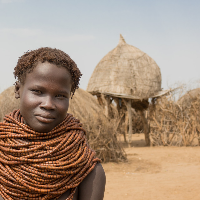 """Young Nyangatom woman in her village, Kangate, Omo Valley, Ethiopia"" stock image"