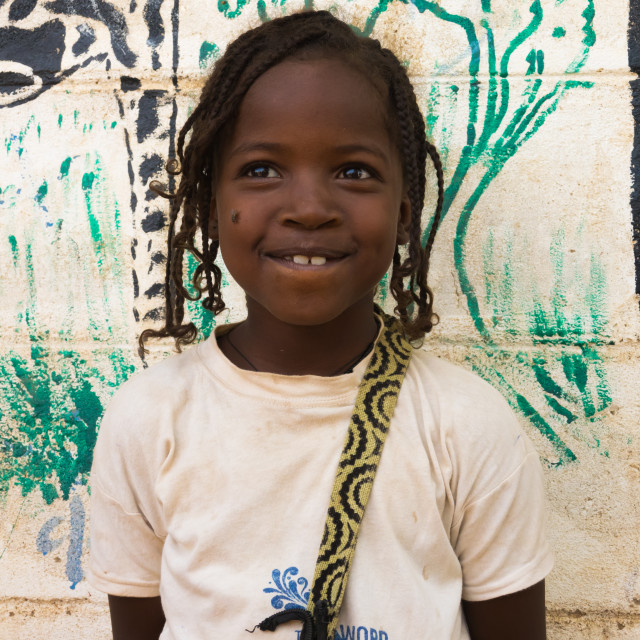 """""""Nyangatom tribe girl in front of a school wall depicting animals, Kangate,..."""" stock image"""