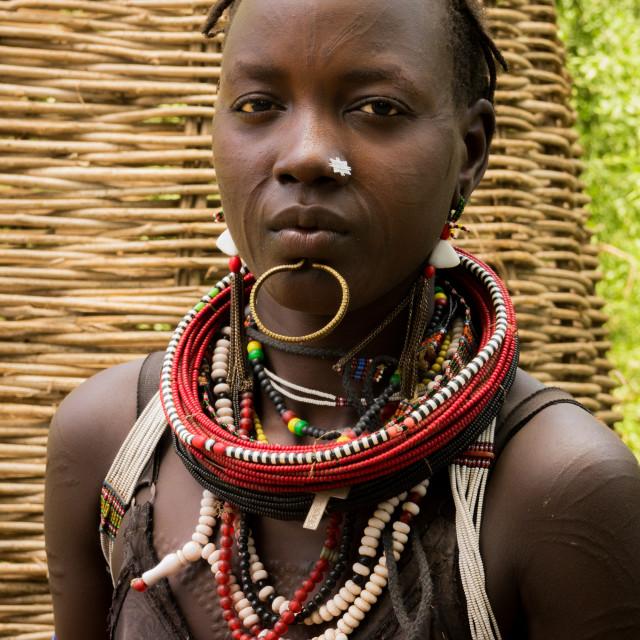 """Sudanese Toposa tribe girl refugee in Kangate, Omo Valley, Ethiopia"" stock image"