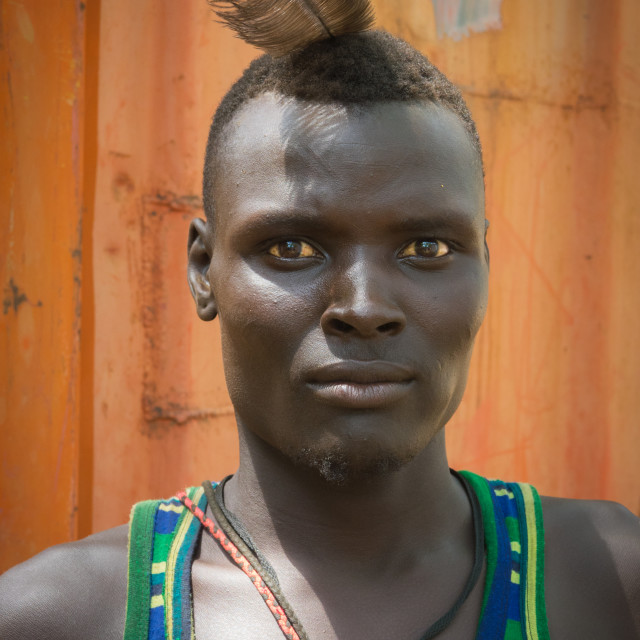 """Sudanese Toposa tribe man refugee in Kangate, Omo Valley, Ethiopia"" stock image"