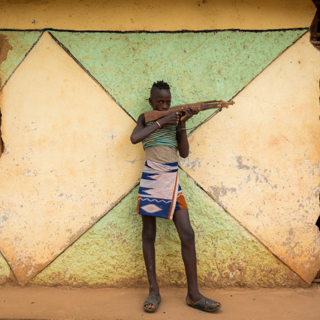 """Hamer tribe boy with a fake wooden gun, Dimeka, Omo valley, Ethiopia"" stock image"