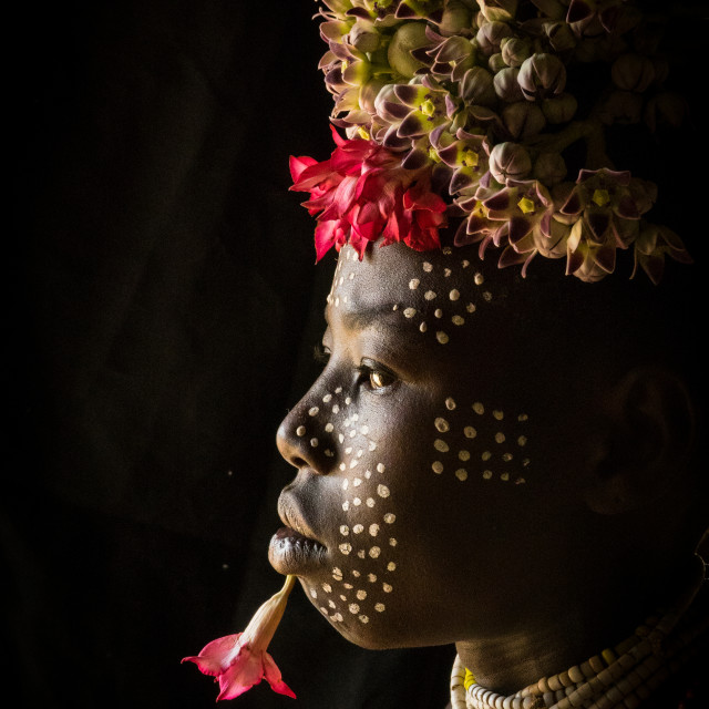 """Karo tribe kid with flowers decorations, Korcho, Omo valley, Ethiopia"" stock image"