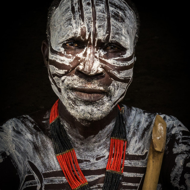 """Karo tribe man with painted face, Korcho, Omo valley, Ethiopia"" stock image"