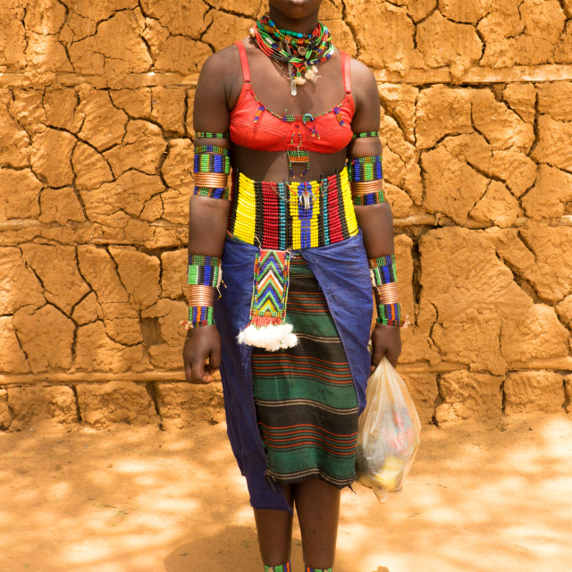 """Stylish Bana girl going to Key Afer market, Omo Valley, Ethiopia"" stock image"