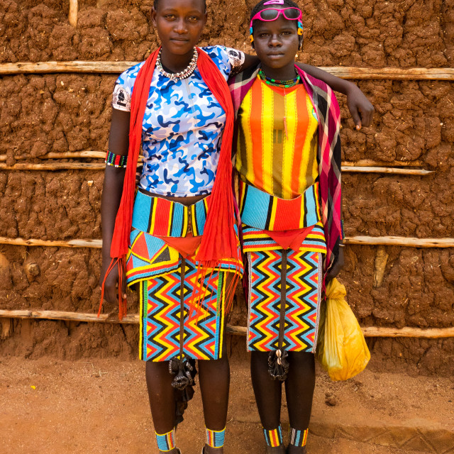 """Stylish Bana girls going to Key Afer market, Omo Valley, Ethiopia"" stock image"