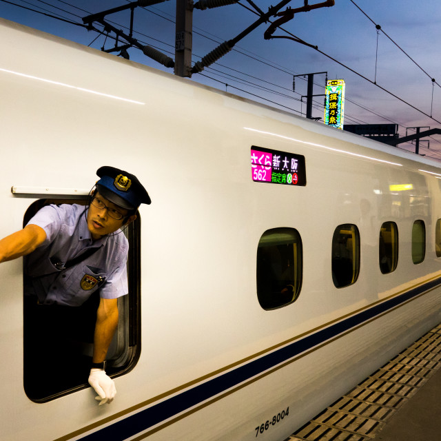 """Train conductor by the window of N700 Shinkansen from Himeji to Osaka-Shi..."" stock image"