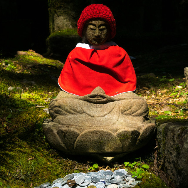 """Decorated Jizo statue in sunlight at Okunoin cemetery, Koya-San Wakayama..."" stock image"