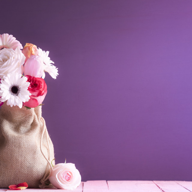 """""""Bouquet of mixed flowers in a cute jute bag"""" stock image"""