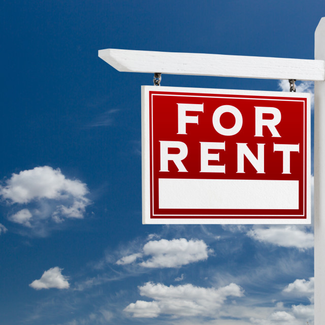 """Left Facing For Rent Real Estate Sign Over Blue Sky and Clouds With Room For..."" stock image"
