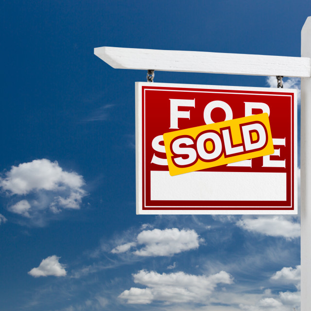 """Left Facing Sold For Sale Real Estate Sign Over Blue Sky and Clouds With Room..."" stock image"