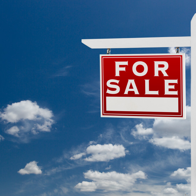 """Left Facing For Sale Real Estate Sign Over Blue Sky and Clouds With Room For..."" stock image"