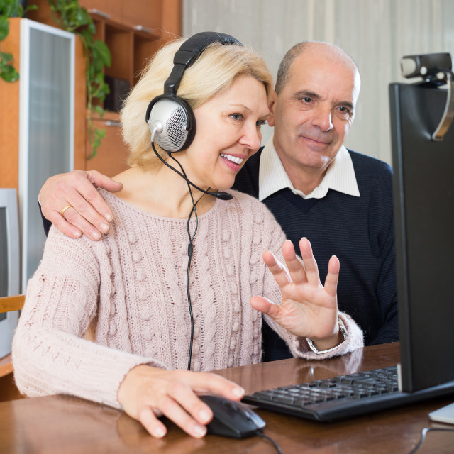 """Pensioner sitting together at the computer"" stock image"