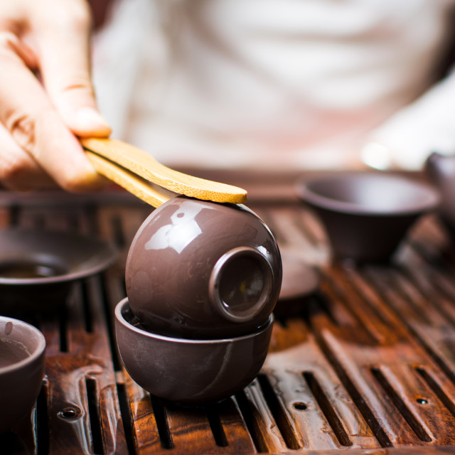 """""""Woman cleaning cup with boiled water during traditional Chinese"""" stock image"""