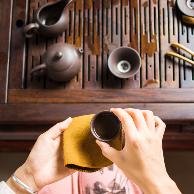 """Woman serving traditionally prepared Chinese tee"" stock image"