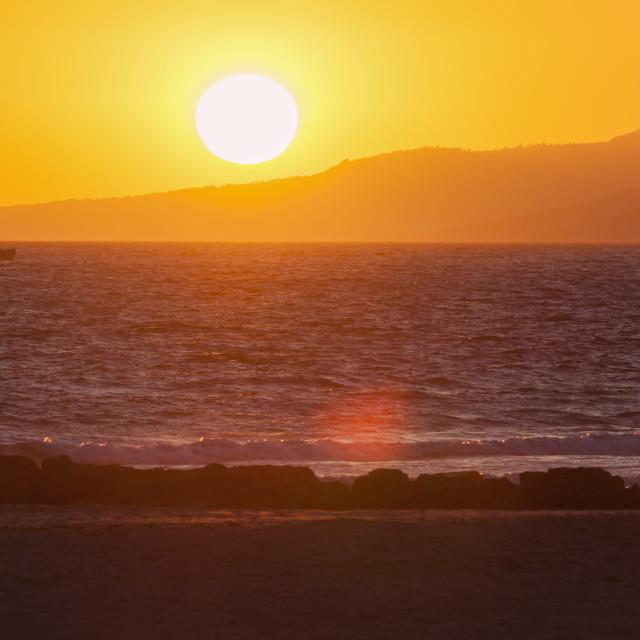 """""""Sunset on the beach in Tarifa"""" stock image"""