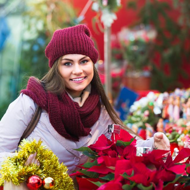 """female customer choosing decorations"" stock image"