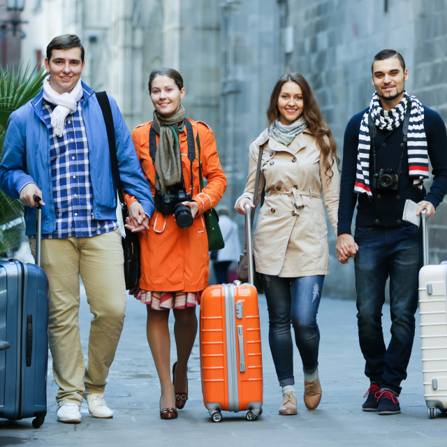 """travelers with baggage sightseeing and smiling in autumn"" stock image"