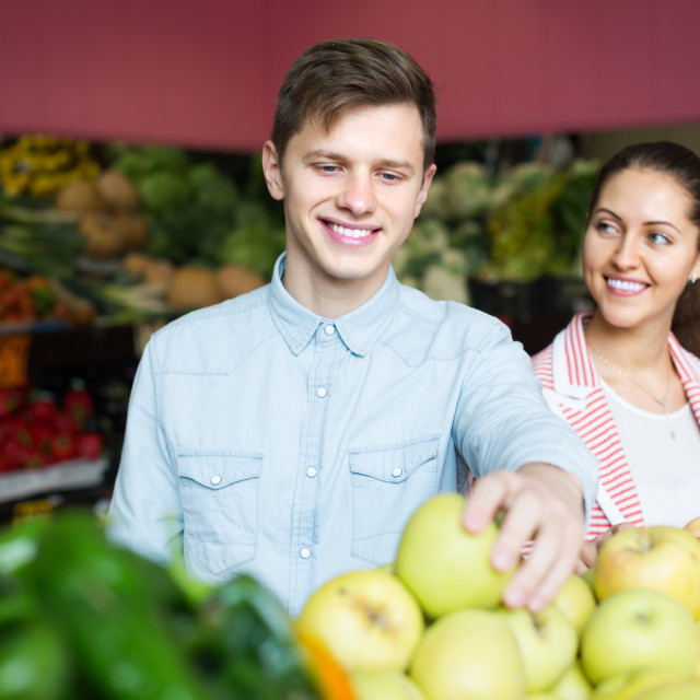 """""""Young couple buying fruits in market"""" stock image"""