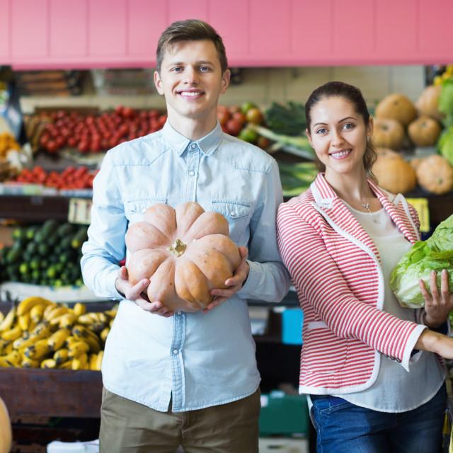 """""""husband helping girl to choose veggies"""" stock image"""