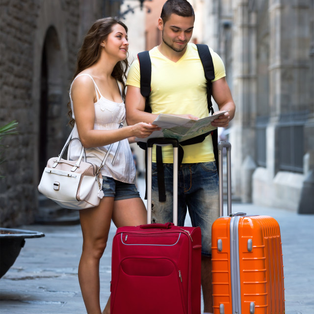 """""""Couple with map on city streets"""" stock image"""