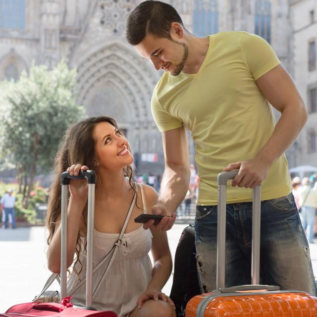 """""""Couple with GPS navigator and baggage"""" stock image"""