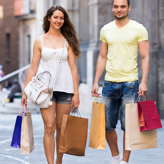 """Happy loving couple with shopping bags at city"" stock image"