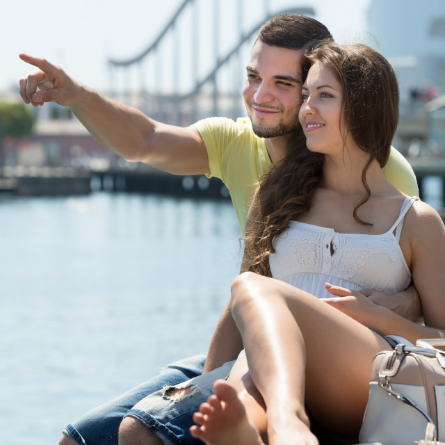 """Couple resting on berth"" stock image"