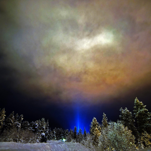 """A light pillar shines like a beacon"" stock image"