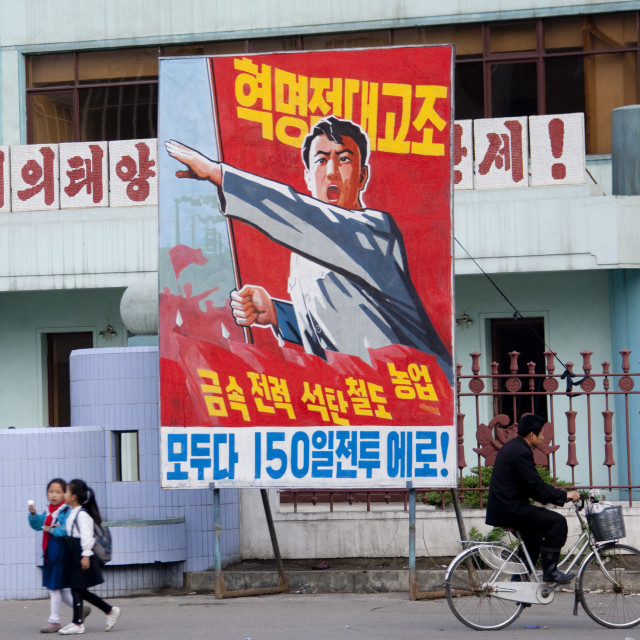 """North Korean people in front of propaganda billboard in the street, South..."" stock image"