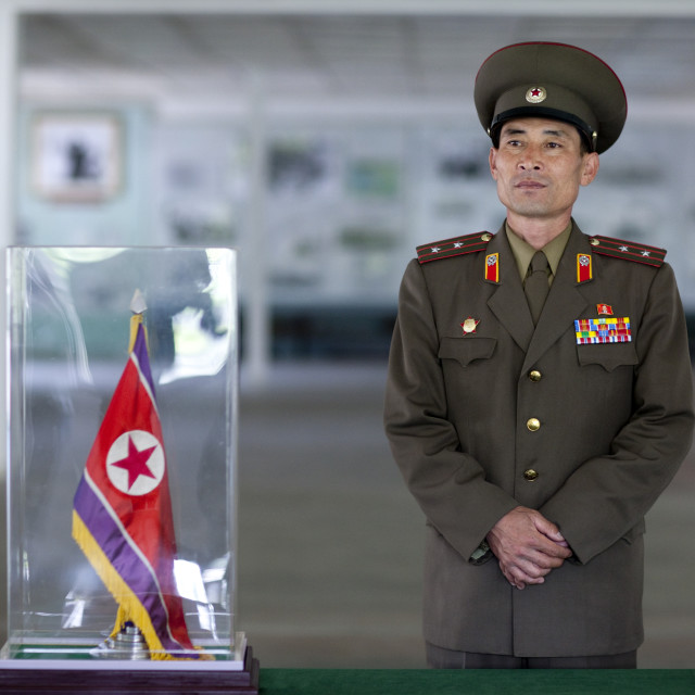 """""""North Korean colonel in front of the armistice document in the North Korea..."""" stock image"""