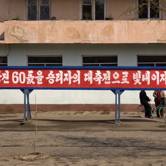 """""""Propaganda slogan on a red billboard in town, South Pyongan Province, Nampo,..."""" stock image"""