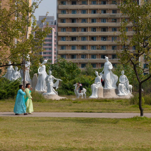 """North Korean women in a park with statues, Pyongan Province, Pyongyang, North..."" stock image"